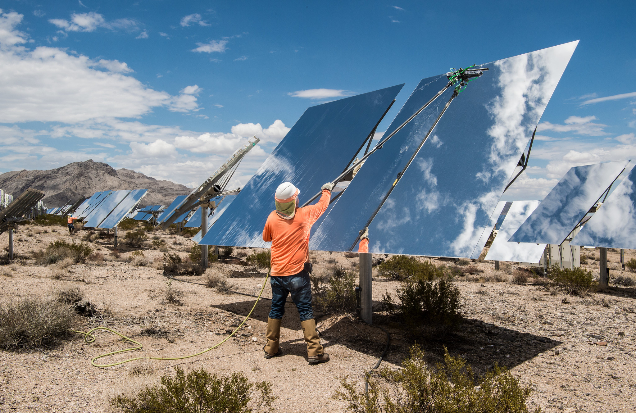 Contracted workers clean Heliostats at the Ivanpah Solar Project, owned by NRG Energy, Bright Source Energy,Bechtel and Google